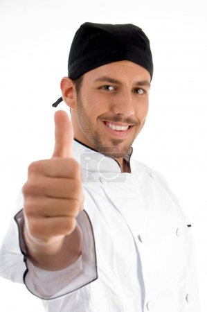 Young chef showing approval sign