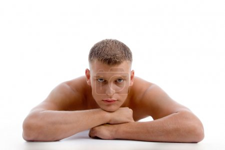 Muscular shirtless male looking at you