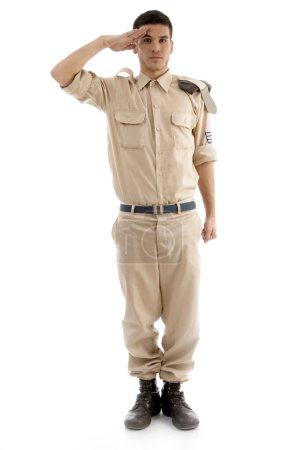 Young saluting american guard
