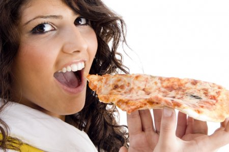 Photo for Pretty woman eating delicious pizza against white background - Royalty Free Image