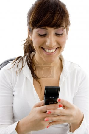 Happy female accountant using cell phone