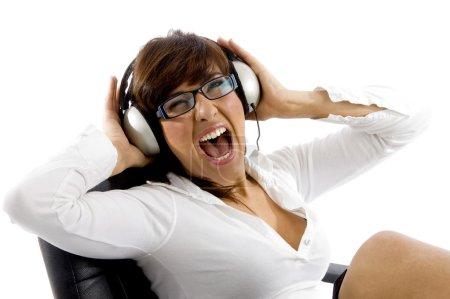 Beautiful lady enjoying loud music