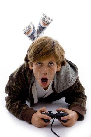 Urprised kid playing videogame