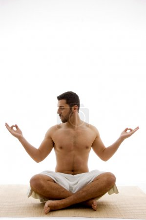 Young man in yoga pose