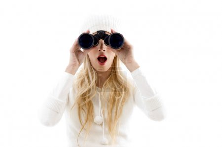 Amazed woman looking through binoculars
