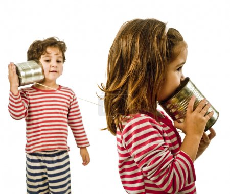Photo for Boy and girl talking on a tin phone isolated on white - Royalty Free Image