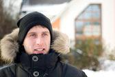 Winter - happy man in cap