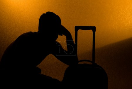 Travel and wait - silhouette of man