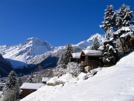 Chalets in a snow white valley