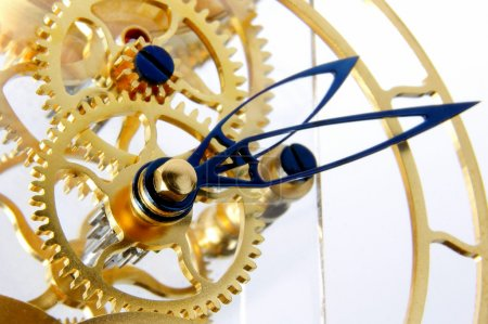 Photo for Details of the mechanism of a gold mechanical clock - Royalty Free Image