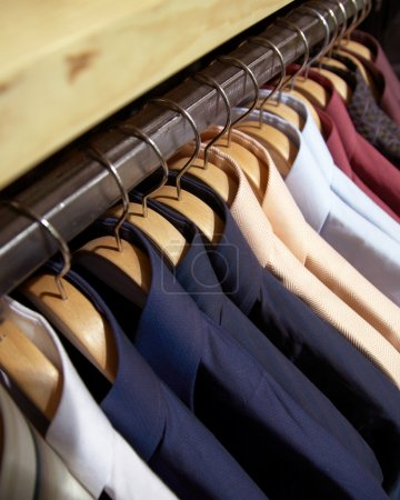 Photo for Clothes hanger with man's shirts - Royalty Free Image