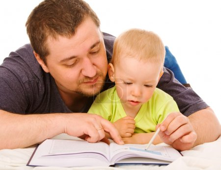 Photo for The son with father reads the book on a white background - Royalty Free Image