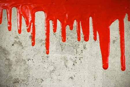 Red paint pouring on vintage background