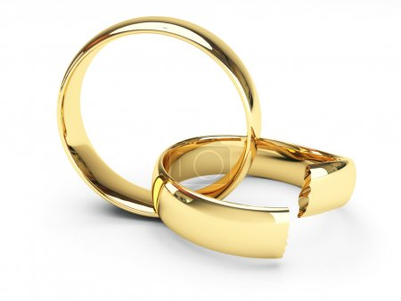 Photo for Isolated broken gold wedding rings - Royalty Free Image