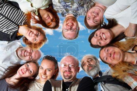 Happy team. On blue sky