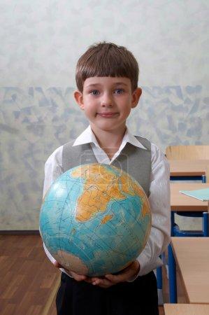 Elementary school. Schoolboy with globe