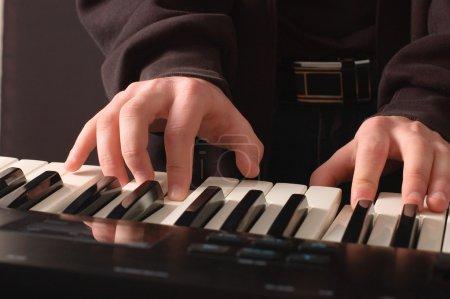 Beautiful men's hands on the keys