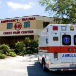 An ambulance pulls into a modern hospital emergenc...