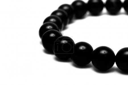 Black beads isolated on white