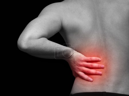 Photo for Back pain isolated on black - Royalty Free Image