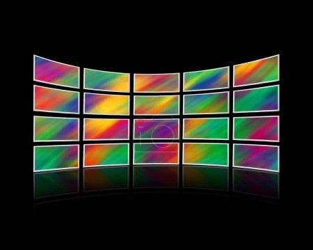 Photo pour Chambre avec un mur d'écrans de télévision - image libre de droit
