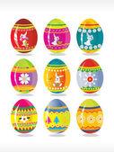 Colorful designer eggs on white