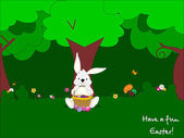 Easter bunny under a tree on grass
