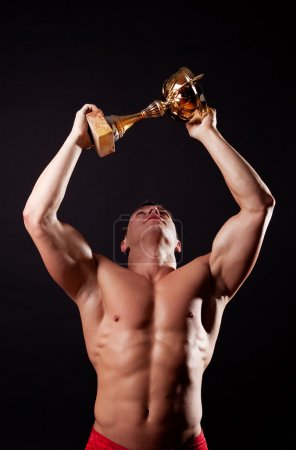 Champion lifting up his cup