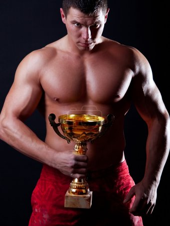 Picture of athlete with his cup