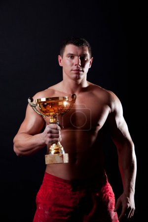Athlete showing a trophy