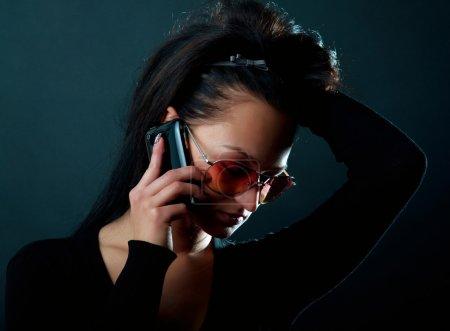 Attractive brunette speaking on phone