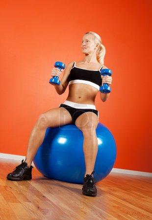 Happy athlete on fitness ball