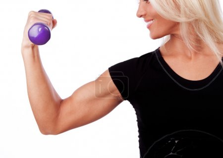 Photo for Image of smiling blonde lifting a weights - Royalty Free Image