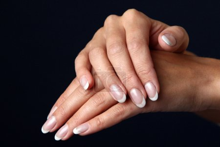 Photo for Beautiful woman hand with french manicure, isolated on black background - Royalty Free Image