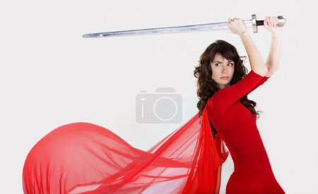 Photo for Young beautiful girl with a sword in hands - Royalty Free Image