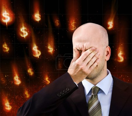 Photo for Businessman suffers from a headache.Dollar falling - Royalty Free Image
