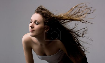 Photo for Young beautiful girl enjoys a fresh wind - Royalty Free Image