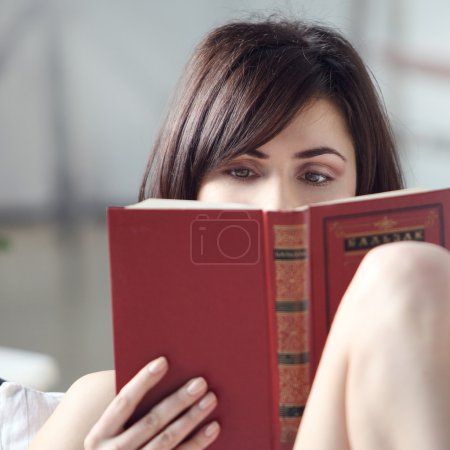 Photo for Reading the book, young beautiful girl reads book - Royalty Free Image