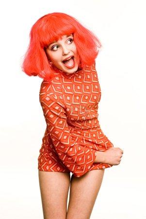 Photo pour Petite poupée rouge poil hurlant fille en petite robe - image libre de droit