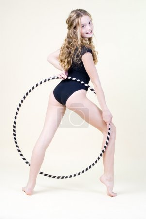 Photo for Pretty smiling girl with hoop looking back - Royalty Free Image