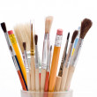 Pencils and brushes closeup at white background...