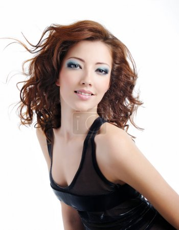 Fashion model woman with blown hairs
