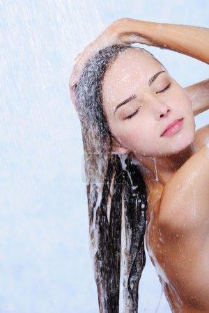 Pretty beautiful woman washing her hair