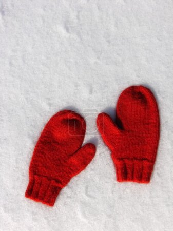 Photo for Pair of hand knit mittens on snow - Royalty Free Image