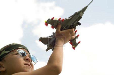 Little boy and war-plane