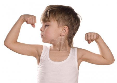 Little boy flexing biceps
