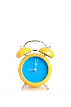 Photo for Yellow alarm clock close up, over white background. - Royalty Free Image
