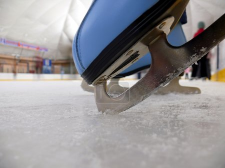 Blue figure skate in the ice