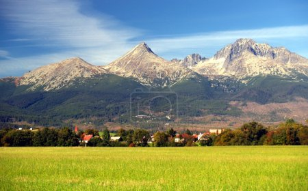 A view of The Tatra Mountains and village in summe...