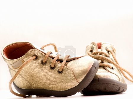Trendy little golden baby shoes